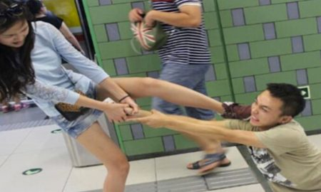 smartphone-gamer-dragged-through-the-subway
