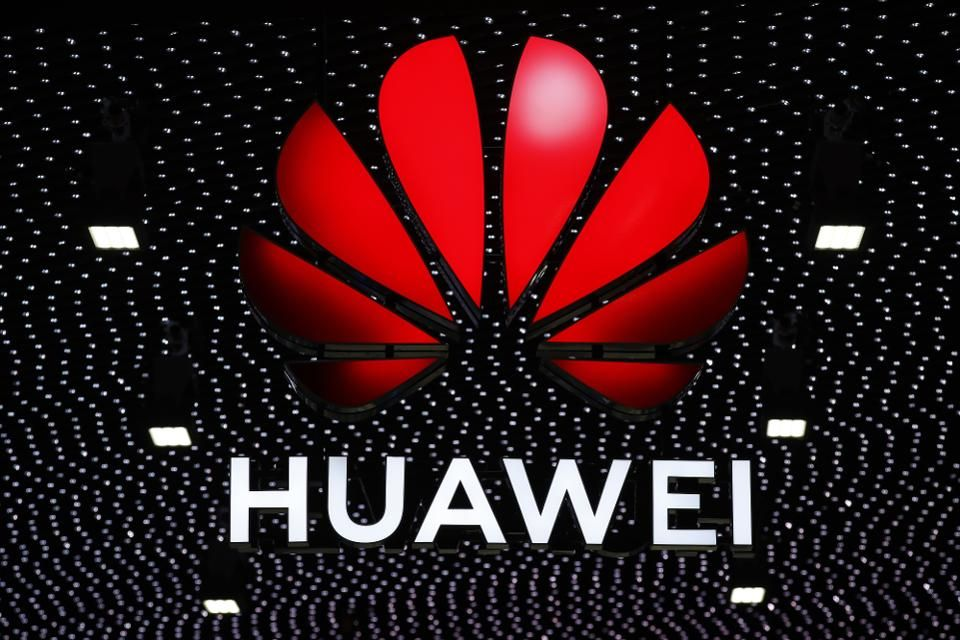 An illuminated logo stands above the Huawei Technologies Co