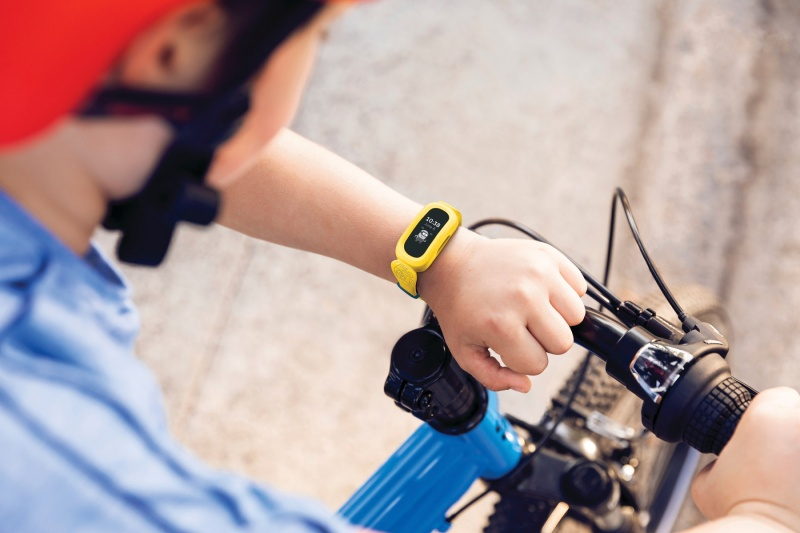 Lifestyle photo of Fitbit Ace 3 Minions band.